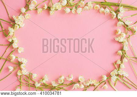Flowers Frame Flat Lay On Pink Paper. Stylish Floral Greeting Card With Space For Text. Hello Spring
