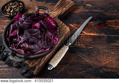 Swiss Red Chard Or Mangold Salad Leafs In A Pan. Dark Wooden Background. Top View. Copy Space