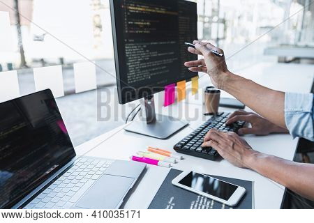 Writing Codes And Typing Data Code Technology, Programmer Cooperating Working On Web Site Project In