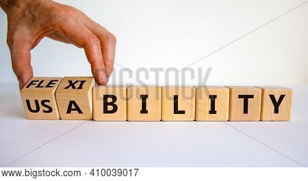 Flexibility And Usability Symbol. Businessman Turns Wooden Cubes And Changes Words 'usability' To 'f