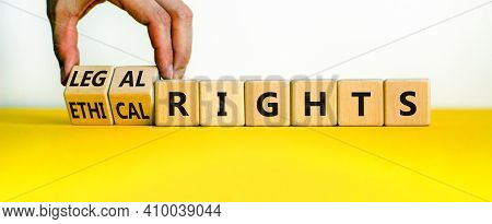 Ethical Or Legal Rights Symbol. Businessman Turns Wooden Cubes And Changes Words Ethical Rights To L