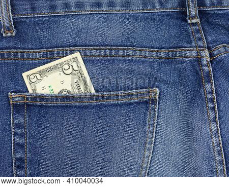 5 Dollar Bill In Jeans Pocket Close-up. Pocket Money Concept. Cash For Payment.