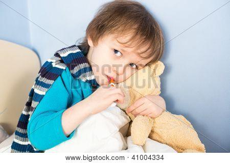 Sick Little Boy Checking His Body Temperature