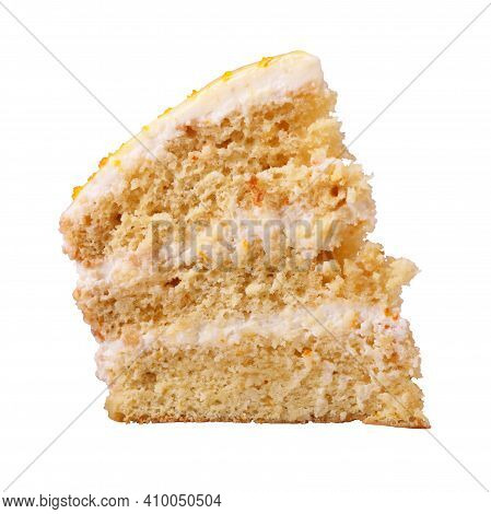 A Piece Of Biscuit Creamy Cake Glazed With Yellow Glaze And Decorated With Shavings Of Orange Peel I