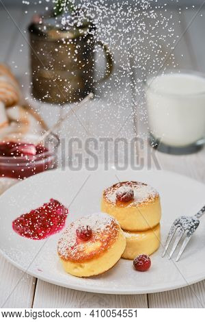 Fried Curd Pancakes - Cheese Pancakes Dusted With Icing Sugar On Plate On The White Wooden Table. He