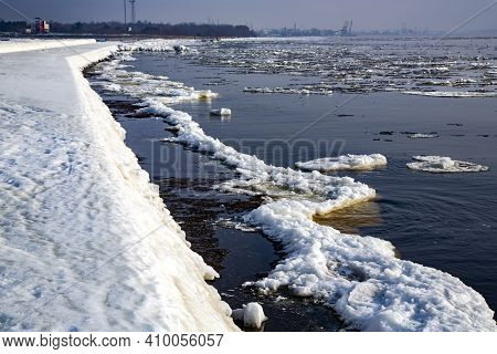 Ice Covered Rocky Coast Of The Baltic Sea On Wintertime In Latvia.white Snow, Ice Covers The Land On