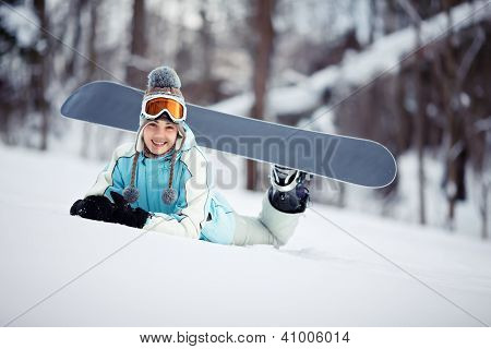 Happy Female Snowboarder Resting