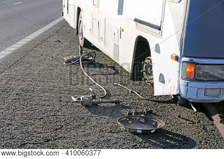 Mechanic Repairing A Flat Tyre On A Motorhome