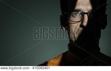 Studio shot of a serious handsome man