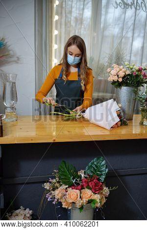 Florist Woman Creates Flower Arrangement. Small Flower Shop. European Floral Shop Concept. Flowers D