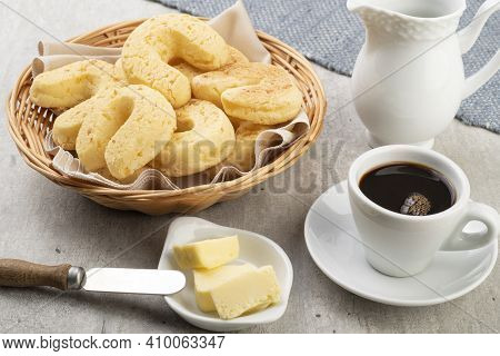 Chipas, Typical South American Cheese Bun In A Basket With Butter And Coffee.