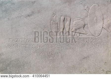 Sevastopol, Crimea - January 31, 2021: Fragment Of An Ancient Greek Marble Tombstone On The Grave Of