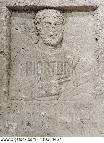 Sevastopol, Crimea - January 31, 2021: Fragment Of An Ancient Greek Tombstone On The Grave Of A Man