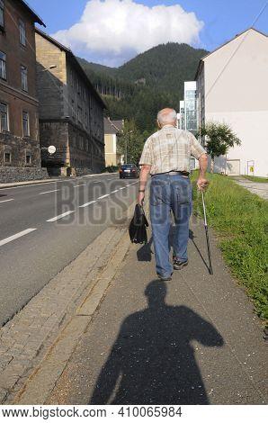 Senior Man With A Walking Stick