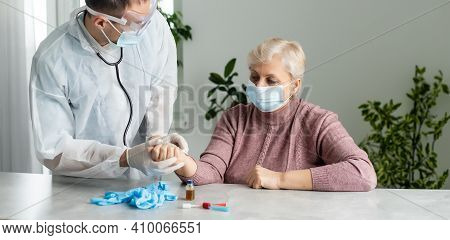 Portrait Of Elderly Caucasian Woman Wearing Protective Medical Mask. Care For The Elderly People Dur