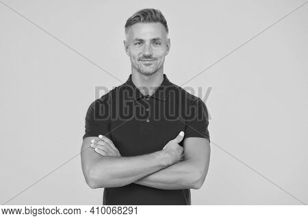 Confidence Looks Cool On Him. Confident Guy Keep Arms Crossed Yellow Background. Barbershop. Hair Sa