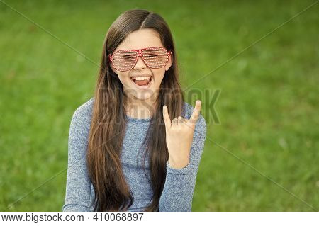 Rock Is Cool. Cool Child Show Hand Horns Outdoors. Happy Girl Party On Green Grass. Fashion Accessor