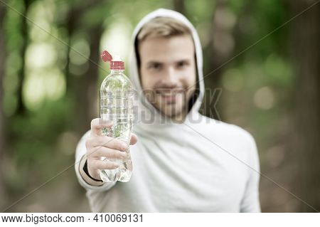 Stay Hydrated. Man Athletic Sportsman Hold Bottle Water. Man Athlete Sport Clothes Care About Water