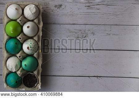 Green And White Easter Eggs In Egg Carton. Candle Egg, Gypsum Egg, Poultry Egg, Ground. Copy Space O