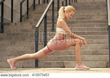 Now Some Stretching Exercises. Athletic Woman Stretching Legs Outdoors. Stretching Workout Routine.
