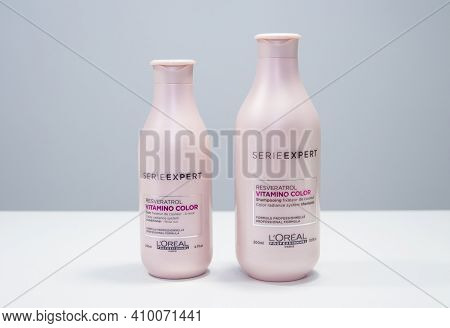 Russia, Kemerovo 01.02.2021. Loreal Professional Hair Cosmetics.pink Bottle On A Light Background. S