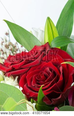 A Beautiful Bouquet Of Red Roses Isolated On A White Background
