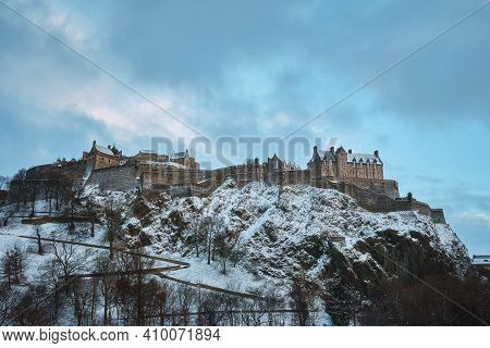 Old Scottish Castle On A Rock Covered With Snow In Winter. View Of Edinburgh Castle, Edinburgh, Scot