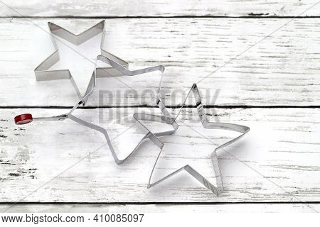 Star Shaped Pastry Cutter On White Wooden Table