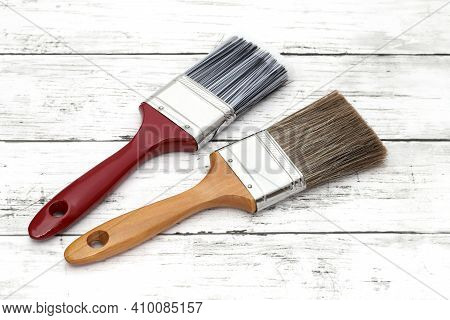 Paint Brush On White Grunge Wooden Table Background