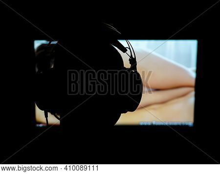 Silhouette Of A Person Watching Internet Porn. Shallow Depth Of Field.