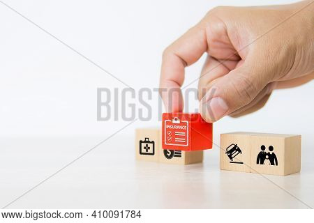 Close-up Hand Chooses Cube Wooden Toy Blocks Stacked With Insurance Prevent And Protect Icon For Saf