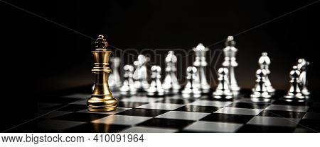 King Chess Standing To Fight Battle Combat With Silver Chess On Chess Board. Concepts Of Business Te