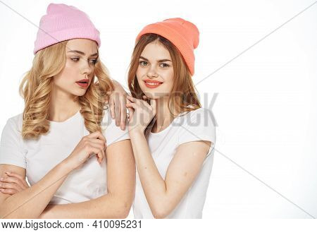 Beautiful Girlfriends Wearing Hats Fashion Clothes Cropped View Light Background