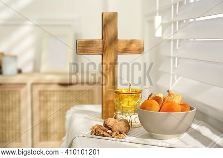 Dried Fruits, Walnuts, Candle And Wooden Cross On Window Sill Indoors. Great Lent Season