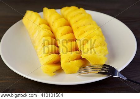 Slices Of Mouthwatering Fresh Ripe Pineapple In White Plate