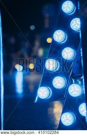Close-up Of Light Blue Neon Lights At Fair.