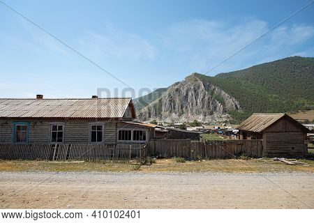 Ancient Wooden Settlement At The Foot Of Mountain. Ancient Village, Monument Of The Times