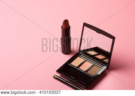 Cosmetic Makeup Eyeshadow And Lipstick On A Pink Background Cosmetic Products For Professional Fashi