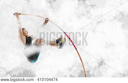 Professional pole vaulter training on smoke background. Sports banner. Horizontal copy space background