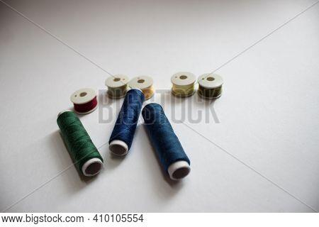 Group Of Three Whole Haberdashery Item Colorful Thread Spools Isolated On White Background. Coloured