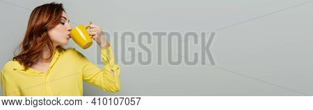 Curly Woman In Yellow Blouse Drinking Tea On Grey, Banner.