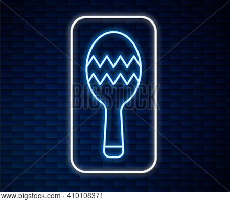 Glowing Neon Line Maracas Icon Isolated On Brick Wall Background. Music Maracas Instrument Mexico. V