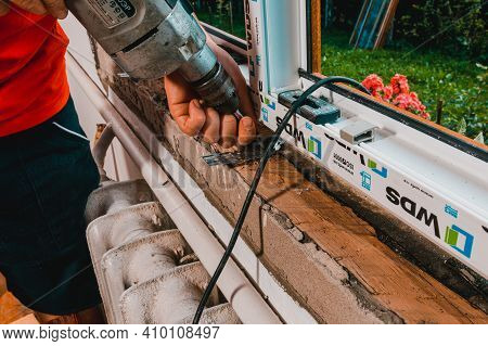Dolyna, Ukraine July 31, 2020: Installation Of A Window Frame And Windows In The House, Windows From