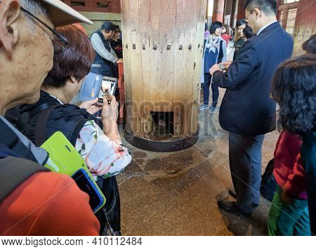 Nara, Japan - April 15, 2018: Hole In A Wooden Pillar At Todai-ji Temple, Nara. Todai-ji Temple Is C