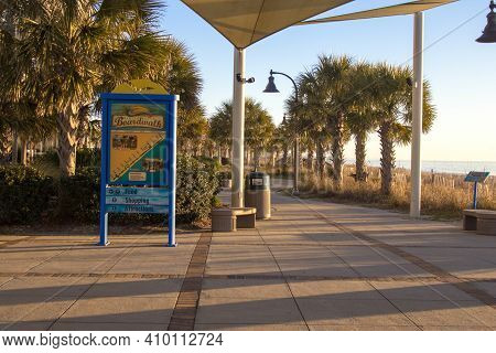 Myrtle Beach, South Carolina, Usa - February 24, 2021: Sign On The Myrtle Beach Boardwalk With Map A
