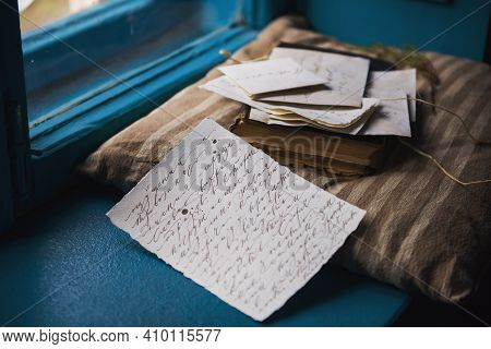 Old Love Letters On The Windowsill.with Thoughts Of The Past Days. Past Feelings And Memories Floode