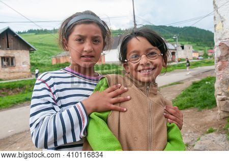 Lomnicka, Slovakia. 05-16-2018. Smiling Gypsy Girls Living In Misery And Poverty In A Abandoned Roma