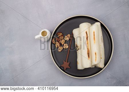 Broiled Bar Rice Cake Korean Food. Stick Of Rounded Rice Cake