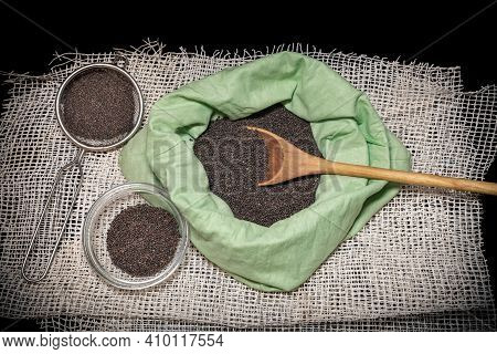 Cabbage Seeds In A Bag And A Wooden Spoon. Collection, Storage And Preparation Of Seeds For Planting