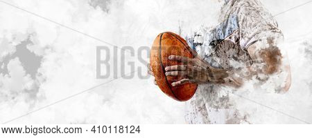 Man rugby player holds ball on smoke background. Sports banner. Horizontal copy space background